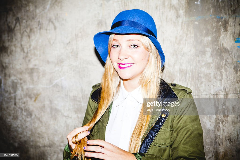 Portrait of a smiling young woman in a blue hat : Stock Photo