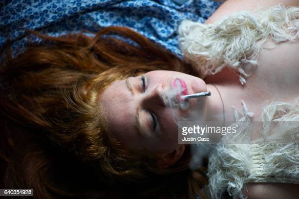 portrait of a smoking woman on a blanket