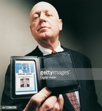 Portrait of a Special Agent Showing his ID Card