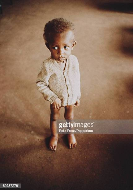 Portrait of a starving and emaciated child from the Biafra region standing alone in a camp during the Nigerian Biafran civil war in Nigeria in August...