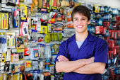 small business: portrait of the proud owner of a home improvement store with tools in the background and copy space