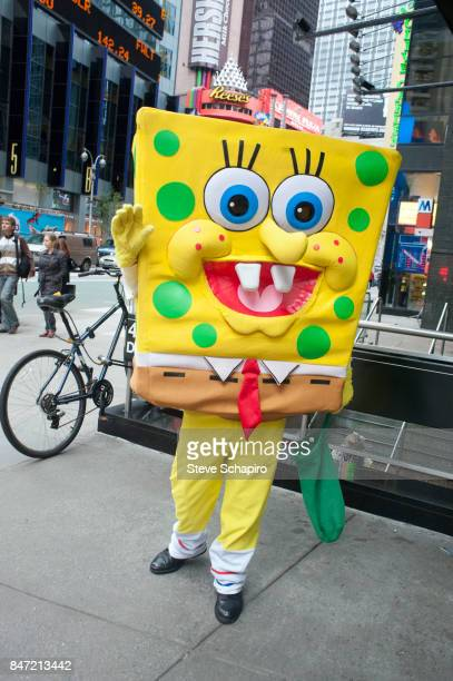 Portrait of a street performer in costume as cartoon character SpongeBob Squarepants outside the 49th Street subway station in Times Square New York...