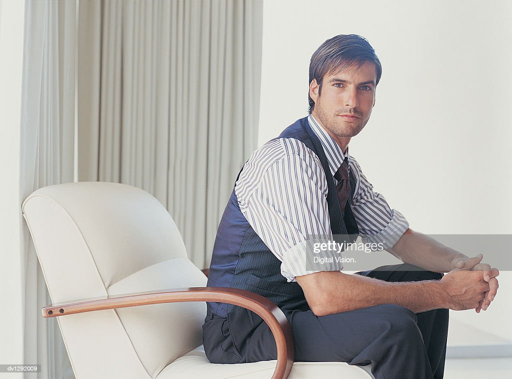 Portrait of a Stylish Businessman Sitting in an Armchair : Stock Photo