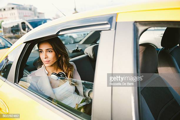 Portrait Of A Successful Businesswoman In A Taxi Using Tablet