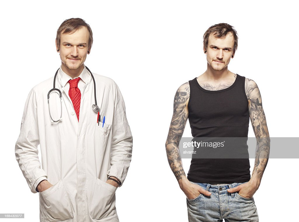 Portrait of a tattooed doctor : Stock Photo