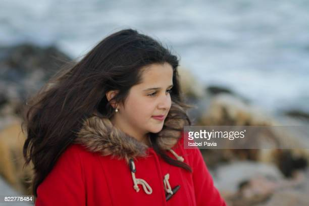 Portrait of a teen girl looking out to sea.