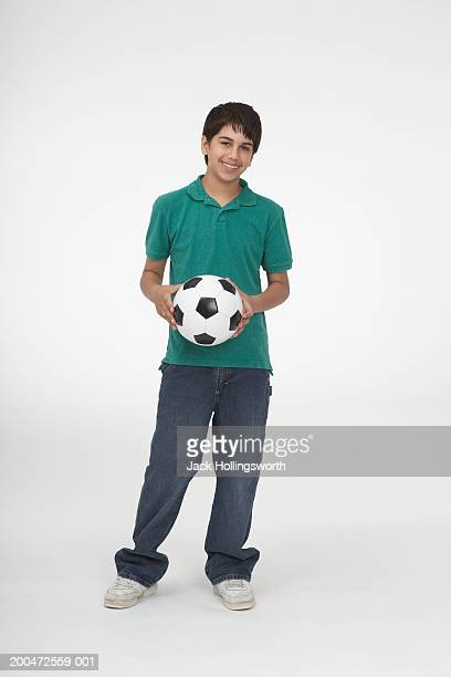 Portrait of a teenage boy holding a soccer ball