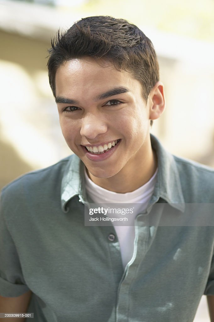 Portrait of a teenage boy smiling : Stock Photo