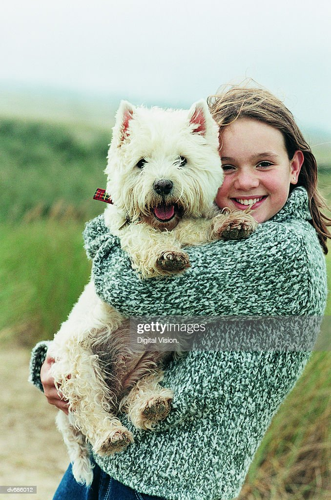 Portrait of a Teenage Girl Holding Her West Highland Terrier : Stock Photo