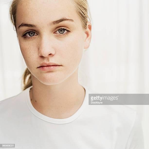 portrait of a teenage girl looking pensive