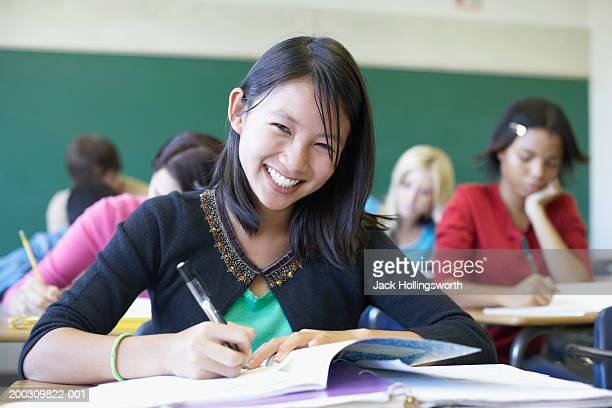 Portrait of a teenage girl sitting in a classroom