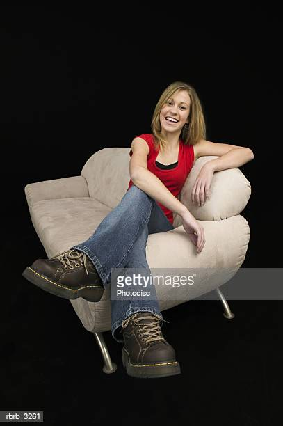 Portrait of a teenage girl sitting on a couch smiling
