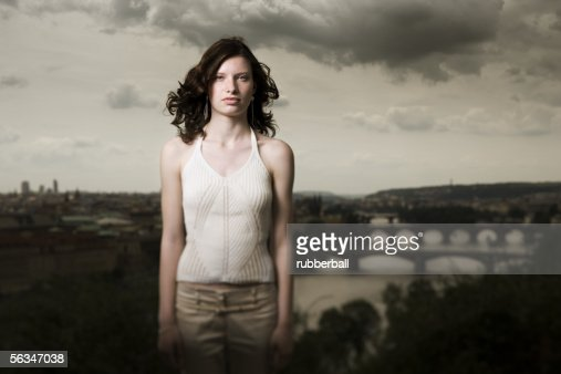 Portrait of a teenage girl standing in front of landscape