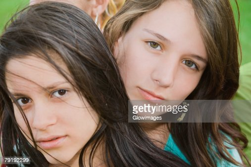 Portrait of a teenage girl with a young woman : Foto de stock