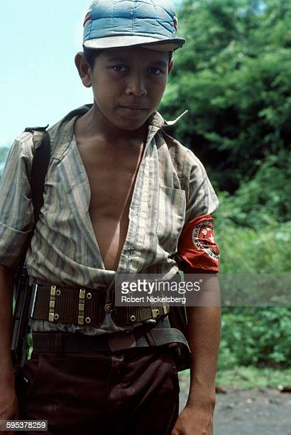 Portrait of a teenage People's Revolutionary Army guerrilla as he stands along a highway southeastern El Salvador September 1 1983 At the time the...