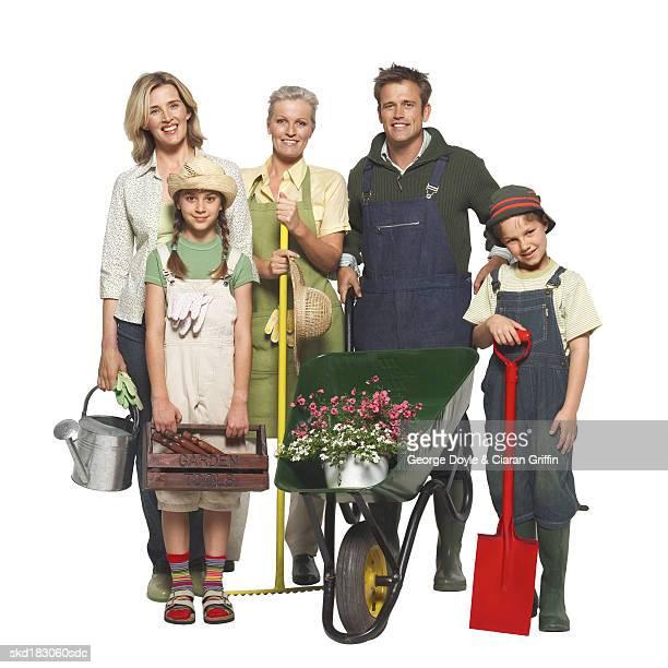 Portrait of a three generation family gardening