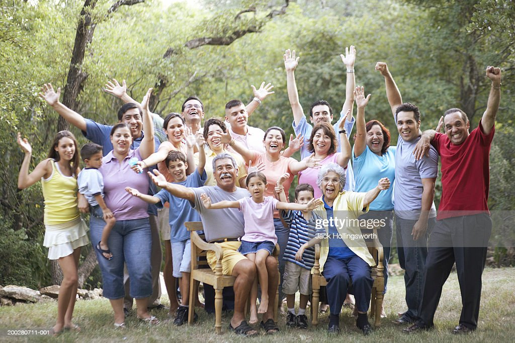 Portrait of a three generation family waving : Stock Photo