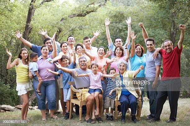 Portrait of a three generation family waving