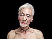 Portrait of a transvestite Asian senior man