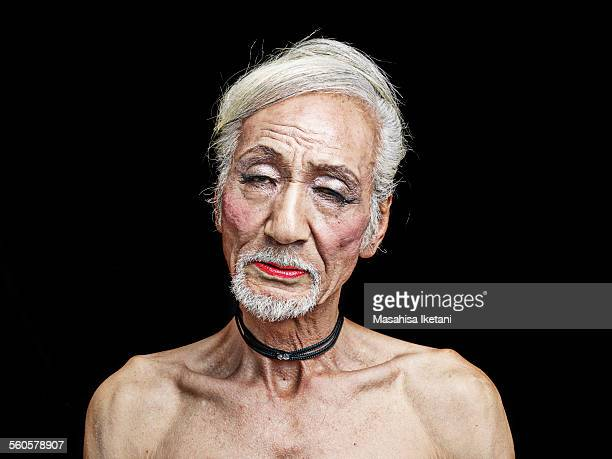 Portrait of a transvestite Asian senior man
