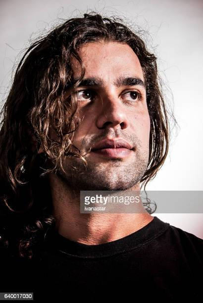 Portrait of a trendy hipster young man, long hair