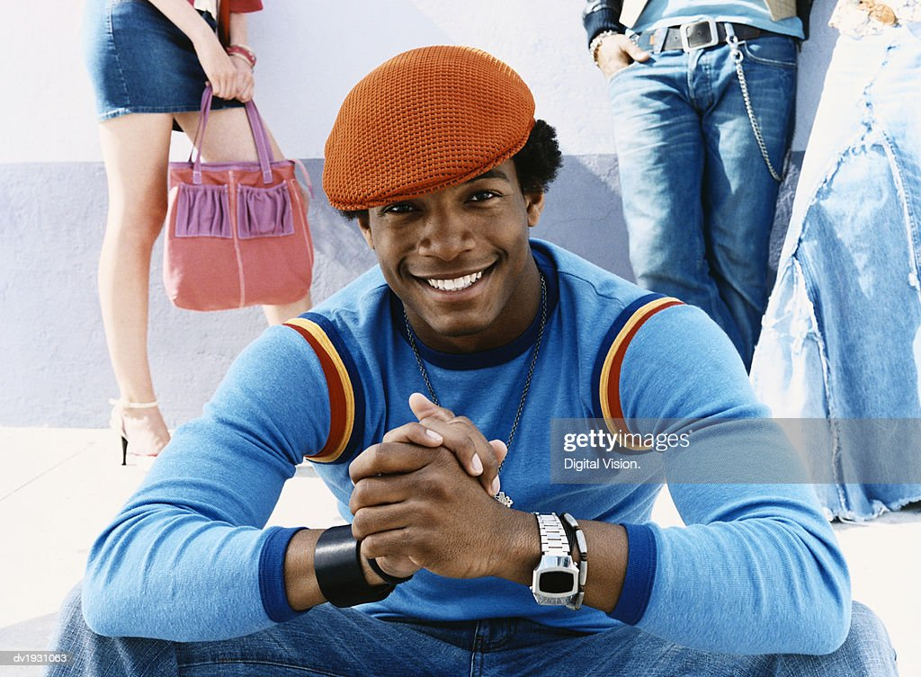 Portrait of a Trendy Young Men Wearing an Orange Cap : Stock Photo