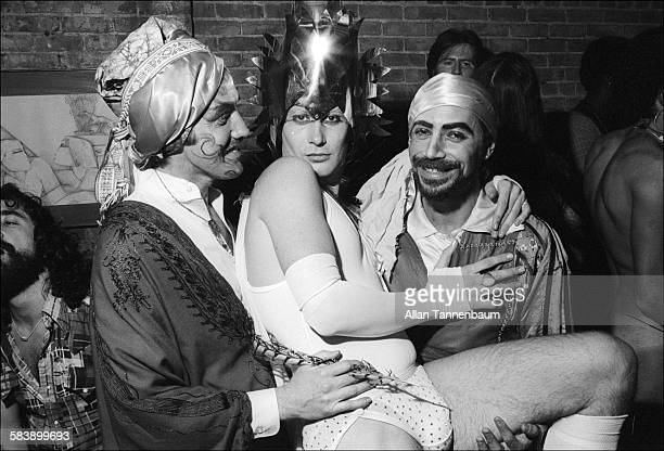 Portrait of a trio men in costumes at a Halloween party in a SoHo loft New York New York October 31 1974