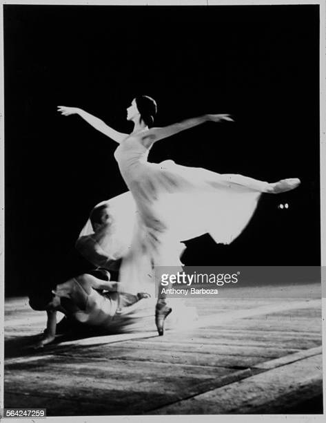 Portrait of a trio of ballet dancers two women and a man as they perform onstage New York 1950s