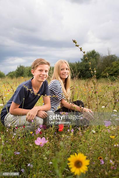 Portrait of a twelveyearold girl and fourteenyearold boy on a flower meadow on August 12 in Duelmen Germany Photo by Ute Grabowsky/Photothek via...