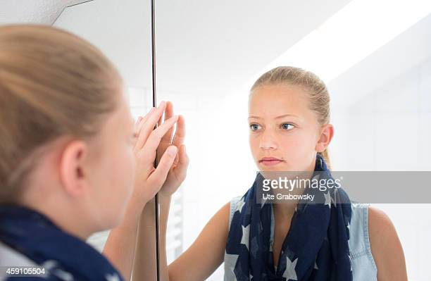Portrait of a twelveyearold girl in front of a mirror on August 12 in Duelmen Germany Photo by Ute Grabowsky/Photothek via Getty Images