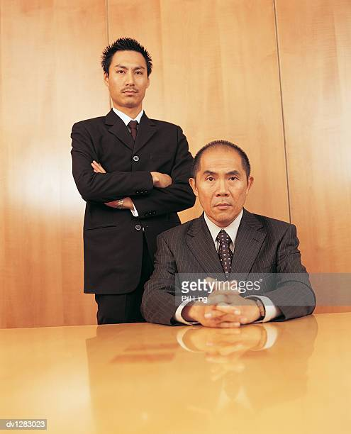 Portrait of a Two Business Executives By a Table