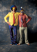Portrait of a two men dressed up as clowns