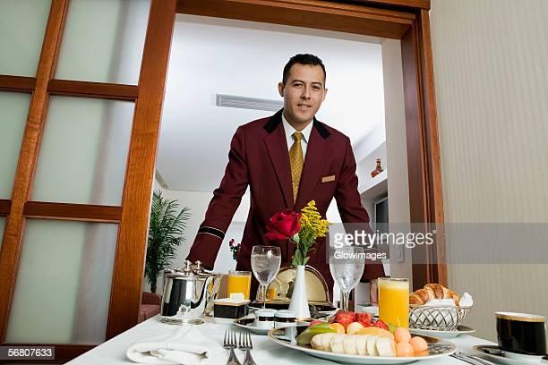 Portrait of a waiter serving food