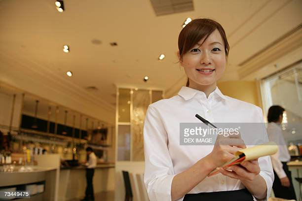 Portrait of a waitress taking an order