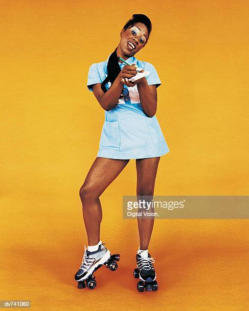 Portrait of a Waitress Wearing Roller-skates
