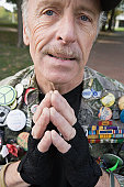 Portrait of a war veteran with his hands folded