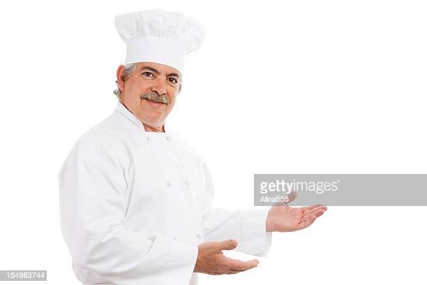 Porträt von einem einladenden cook in Köchen Hut und uniform