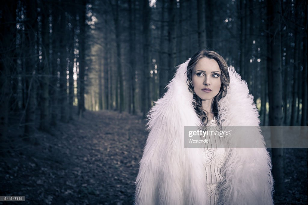 Portrait of a white dressed mystic woman in a forest