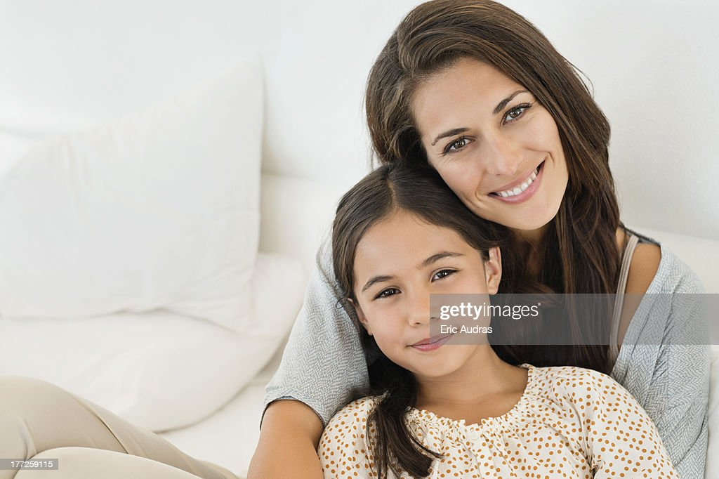 Portrait of a woman and her daughter smiling : Stock Photo