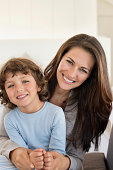 Portrait of a woman and her son smiling