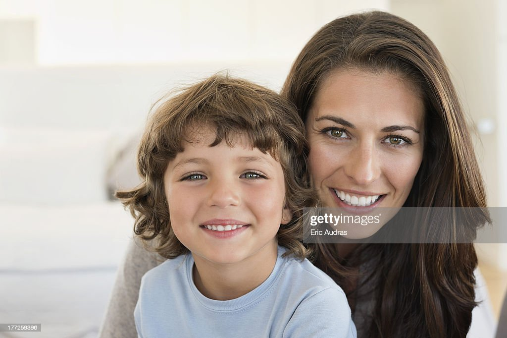 Portrait of a woman and her son smiling : Stock Photo