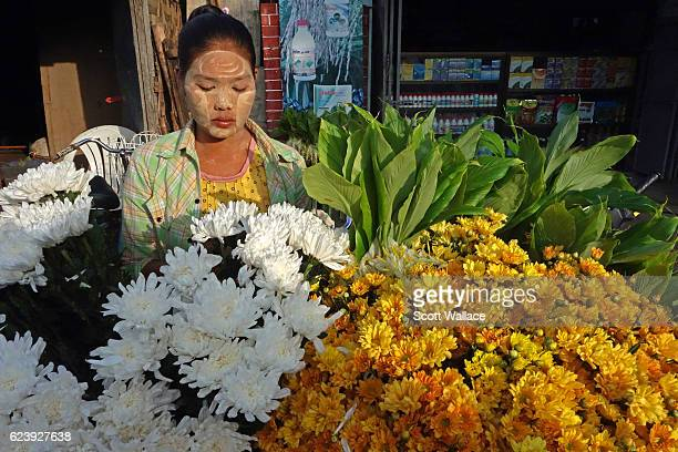 Portrait of a woman as she sells flowers at an outdoor market Pyay Myanmar 2013