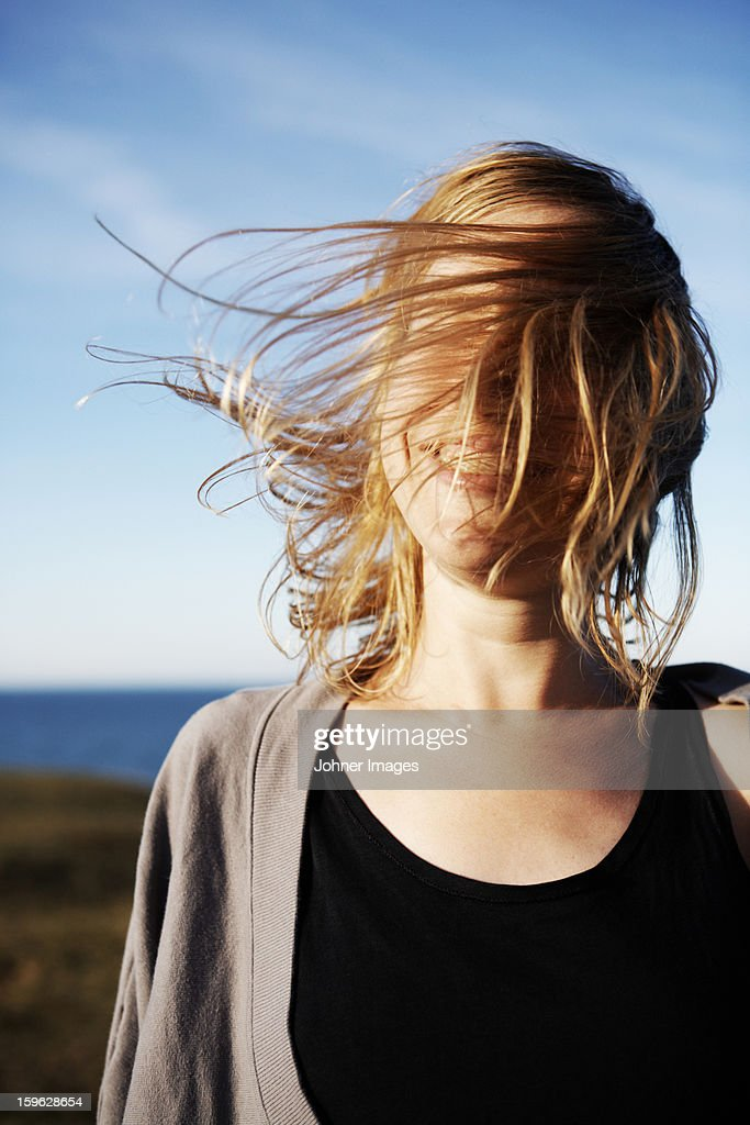 Portrait of a woman by the sea, Sweden.