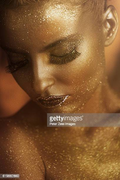 portrait of a woman covered with gold