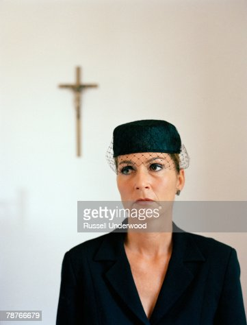 Portrait of a woman dressed in black at a church