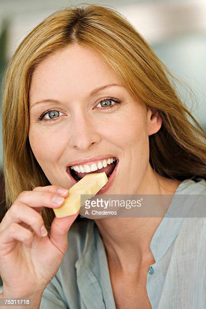 Portrait of a woman eating cheese