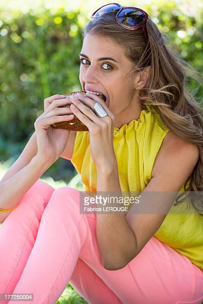 Portrait of a woman eating sandwich