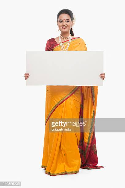 Portrait of a woman holding a blank placard on Gudi Padwa festival
