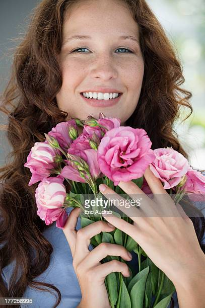 Portrait of a woman holding a bouquet of flowers and smiling