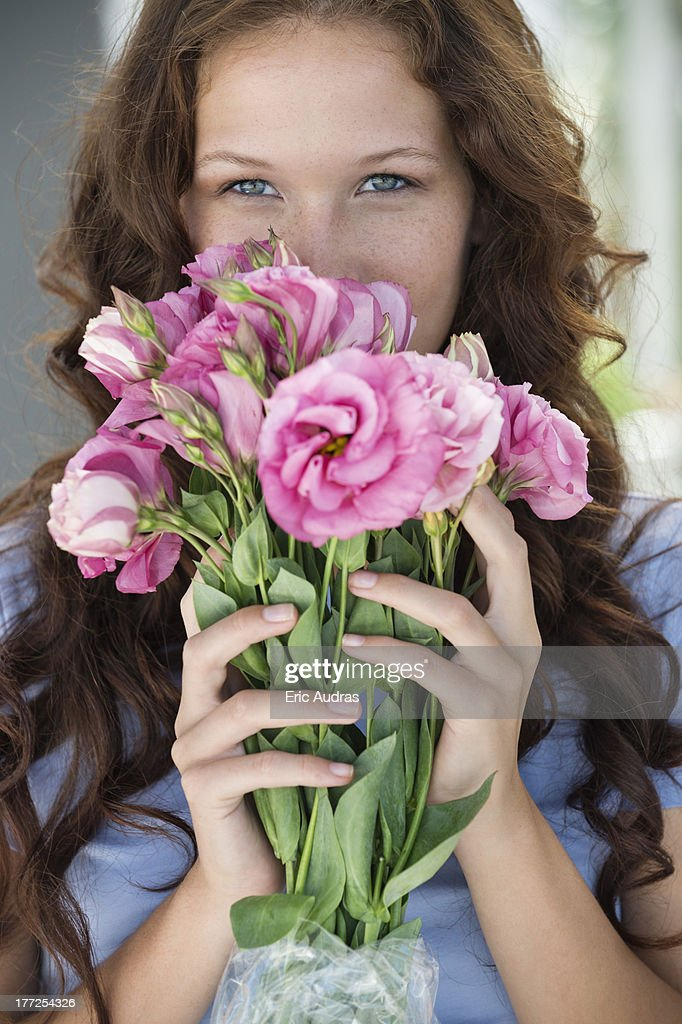 Portrait of a woman holding a bouquet of flowers : Stock Photo
